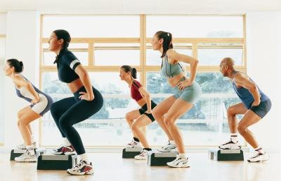 People taking an aerobic step class.