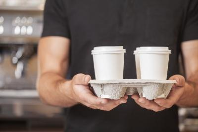 hipsters holding coffee cups