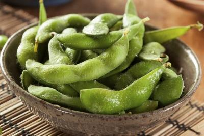 Small bowl of steamed edamame.