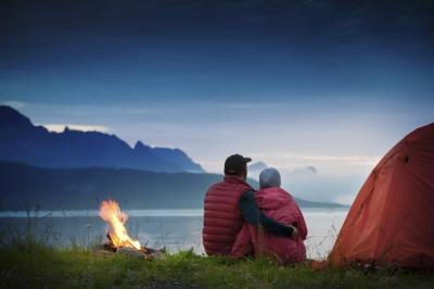Couple hugging outside tent