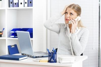 Stressed woman on phone.