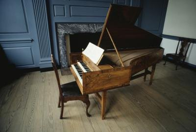 A baby grand wooden piano.