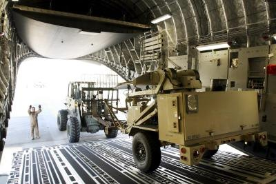 A ground surveillance radar unit is unloaded from a C-17 at Pope AFB
