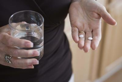 A woman takes pills for a candida problem.