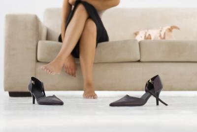 If you do wear high heels, kick them off at the office under your desk and flex and extend the toes