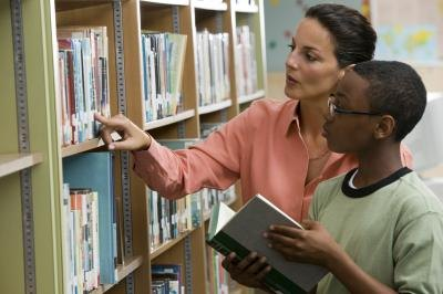 Librarian with student