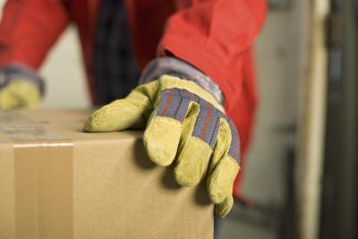 man wearing gloves in wareheouse