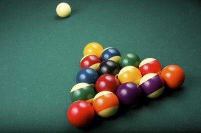 Racked billiards balls and cue ball