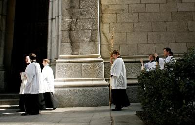 Clergymen walk past St. Patrick's church in New York.