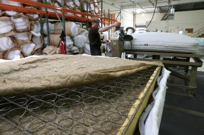 Mattress springs exposed in factory