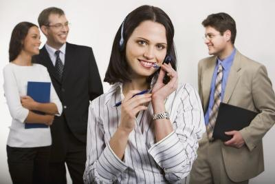 Telephone customer service agent and saleswoman