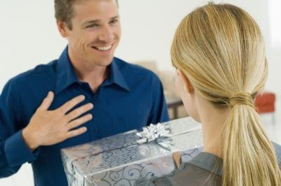 woman giving young man a gift