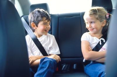 Children riding in back of car