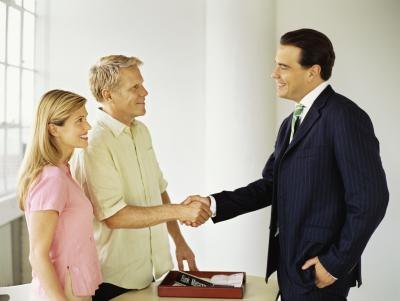 business shaking client's hand