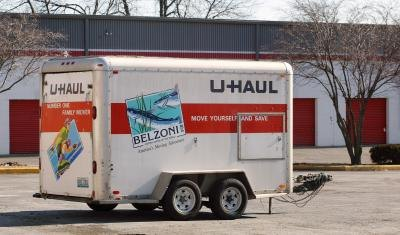 A lone U-Haul trailer in lot