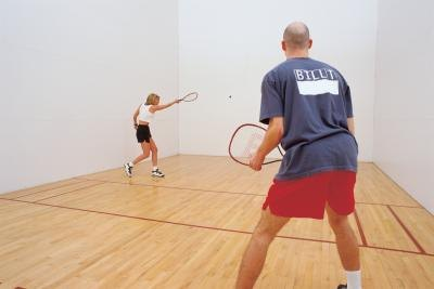 Couple playing racquetball