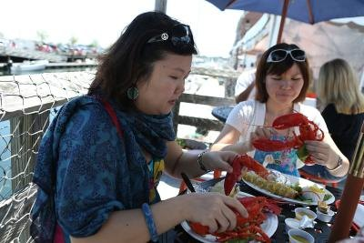 Tourists enjoy cooked lobster in Portland, Maine