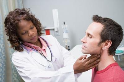 Doctor touching man's neck