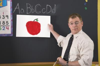 A teacher uses a picture of an apple to help students with disabilities communicate better