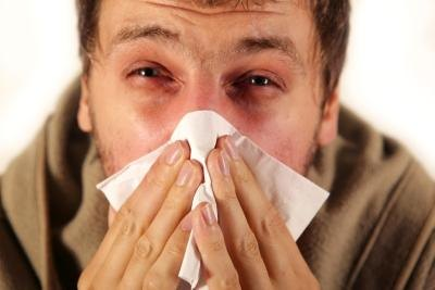 Young man suffering terribly from a sinus infection