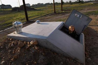 Young girl plays in newly constructed tornado shelter in Joplin, Missouri