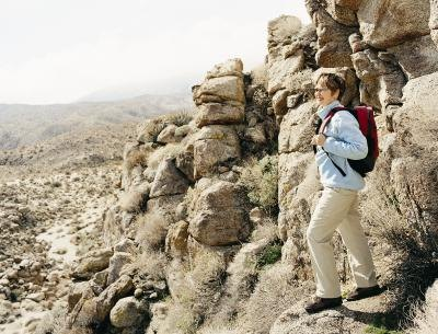 Woman hiking in desert mountains