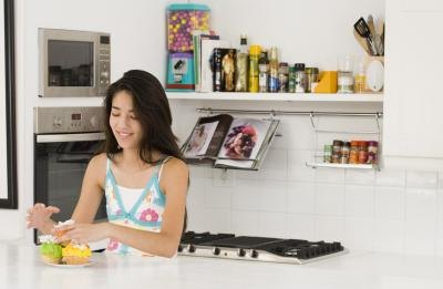 Teenage girl in kitchen