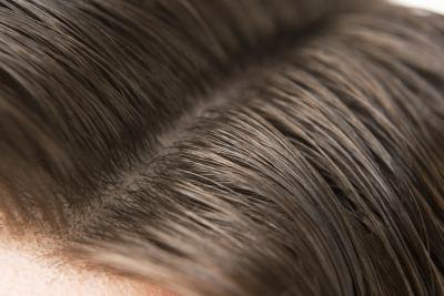 A side part helps reduce the roundness of your face.