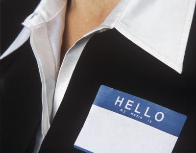 A woman has a blank name tag on her blazer.