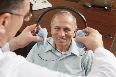 A hearing test is given to patients by the use of a headset.