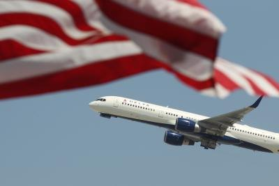 Delta Airlines passing an American flag