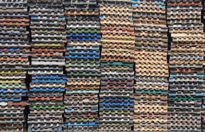 Stockpile of colorful wooden pallets