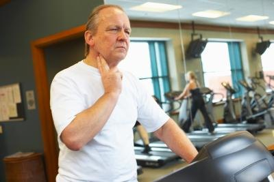 Man checking heart rate at gym