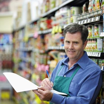 Grocery store manager with clipboard