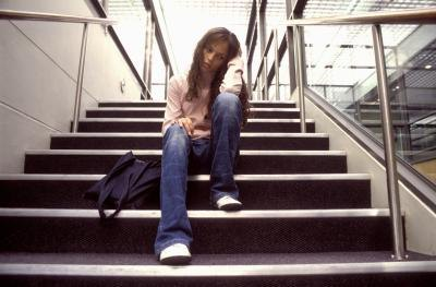 Teen girl sitting on stairs