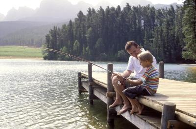 Boy fishing with his dad