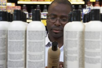 Man reading shampoo label