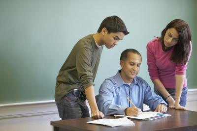 Teacher discussing results with two students