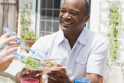 Smiling man with salad