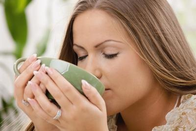 woman drinking hot lemon water