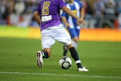 A professional soccer player on a field.