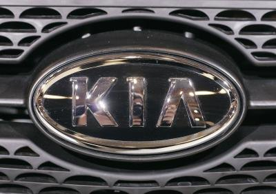KIA brand on front of vehicle