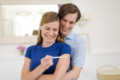 couple reading pregnancy test