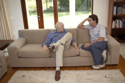 Men talking on couch
