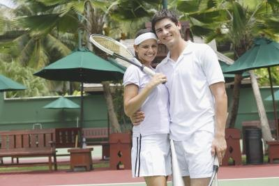 Couple wearing tennis outfits