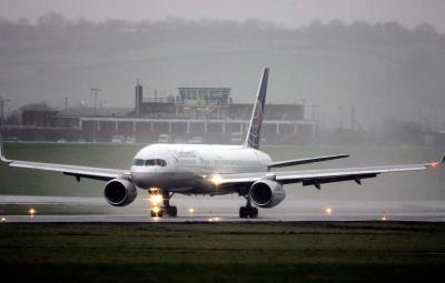 Continental Airliner touching down in the rain