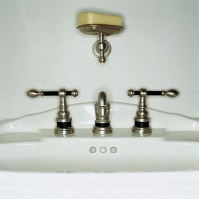 How to repair replace the drain pipes on a bathroom sink ehow for Replacing bathroom drain pipe