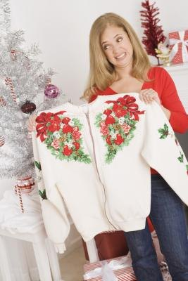 Woman holding up Holiday Sweater