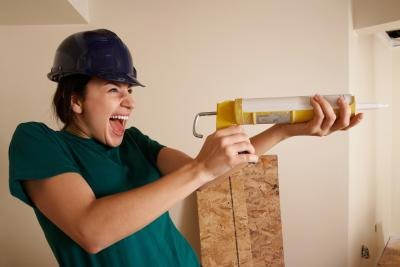 Use silicone caulk and a caulking gun to apply a small amount of caulk over any exposed nail heads.