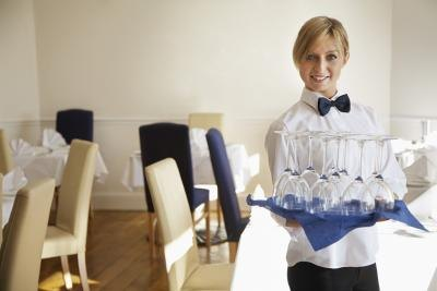 server placing glasses on table